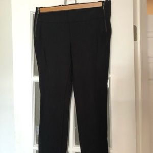 Black tight pants with side zippers